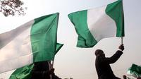 Bendera Nigeria (AFP Photo / Sodiq Adelakuin)