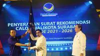 Penyerahan surat rekomendasi calon wali kota Surabaya periode 2021-2026 oleh Partai NasDem. (Foto: Liputan6.com/Dian Kurniawan)