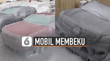Cuaca ekstrem melanda negara Rusia. Membuat beberapa mobil membeku diselimuti oleh bongkahan es.