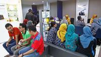 Rata-rata nasabah Bank Mandiri korban skimming pernah bertransaksi di ATM di kawasan Gedung Graha Pena Surabaya. (Liputan6.com/Dian Kurniawan)