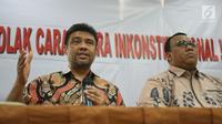 Presiden KSPI Said Iqbal (kiri) dan Presiden KSPSI Andi Gani Nena Wea saat konferensi pers, Jakarta, Rabu (25/9/2019). Kendati menilai revisi UU No 13/2003 tentang Ketenagakerjaan merugikan buruh, serikat pekerja meminta buruh menahan diri dan mengedepankan keutuhan NKRI. (Liputan6.com/Angga Yuniar)
