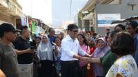 Cagub Sulsel Ichsan Yasin Limpo saat menemui pendukungnya di Jalan Hangtuah, Makassar, Selasa (20/2/2018). (Liputan6.com/Eka Hakim)