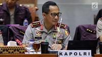 Kapolri Jenderal Pol Tito Karnavian mengikuti rapat kerja dengan Komisi III DPR di Kompleks Parlemen Senayan, Jakarta, Rabu (14/3). Polri juga akan bersinergi dengan aparat penegak hukum lainnya dalam pemberantasan korupsi. (Liputan6.com/Johan Tallo)