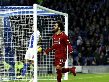 Gelandang Liverpool, Mohamed Salah, merayakan gol yang dicetaknya ke gawang Brighton. (AP/Gareth Fuller)