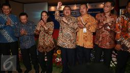 Mentri BUMN Rini Soemarno usai penandatanganan kerja sama 7 BUMN, Jakarta, Kamis (39/12). Ketujuh BUMN yang menjalin sinergi dengan Bank BTN yakni PT Pembangunan Perumahan (Persero) Tbk, PT Semen Indonesia (Persero) Tbk. (Liputan6.com/Angga Yuniar)