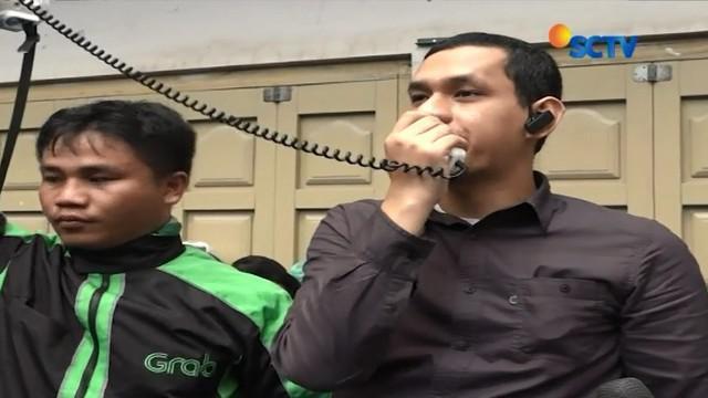 Tuntut pembayaran dana insentif dan promo, ratusan pengemudi Grab motor di Medan, Sumut, lakukan unjuk rasa besar-besaran.