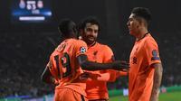 Trio penyerang Liverpool, Sadio Mane, Mohamed Salah, dan Roberto Firmino. (AFP/Francisco Leong)