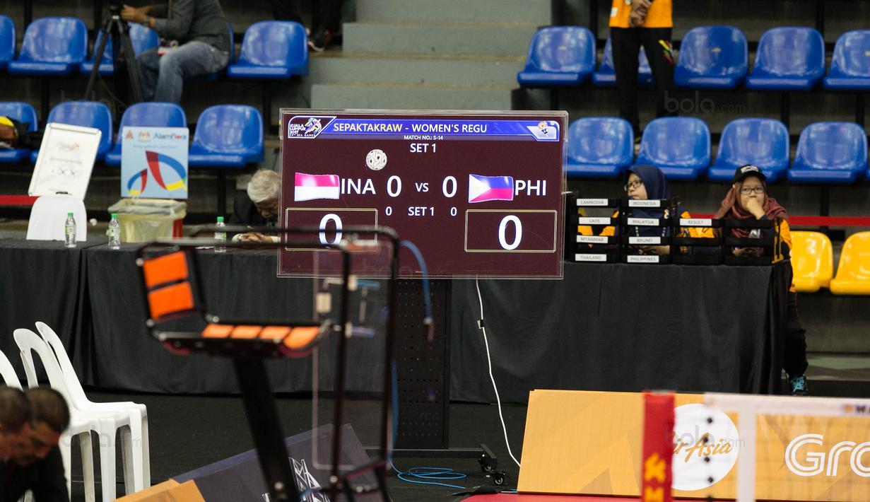 Papan skor Timnas Sepak Takraw Putri Indonesia dan Filipina yang belum berubah pada SEA Games 2017 di Titiwangsa Indoor Stadium Kuala Lumpur, Malaysia, Selasa (21/8). (Bola.com/Liputan6/Faizal Fanani)