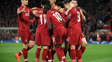 Selebrasi golpertama Liverpool yang dicetak Nabi Keita pada leg 1, babak perempat final Liga Champions yang berlangsung di Stadion Anfield, Liverpool, Rabu (10/4). Liverpool menang 2-0 atas Porto (AFP/Glyn Kirk)