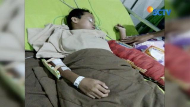 Bocah ini dilarikan ke rumah sakit karena mengalami luka serius usai dikeroyok temannya, karena lakukan gol bunuh diri saat bermain bola.