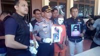 Kapoles Garut AKBP Budi Satria Wiguna saat rilis kasus di Garut (Liputan6.com/Jayadi Supriadin)