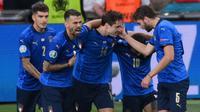 Duel antara Belgia melawan Italia dipastikan akan berlangsung sengit karena akan mempertemukan dua kesebelasan yang memiliki kedalaman skuad yang baik. Berikut lima pemain Italia yang harus diwaspadai oleh Roberto Martinez. (Foto: AFP/Pool/Laurence Griffiths)