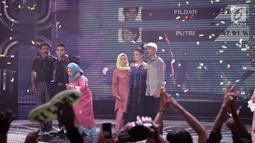 Polling SMS yang menunjukan Fildan memperoleh polling sebesar 52,09 persen dan Putri sebesar 47,91 persen saat pengumuman pemenang Dangdut Academy 4 atau D'Academy 4 di Studio 5 Indosiar, Jakarta, Jumat (19/5). (Liputan6.com/Faizal Fanani)