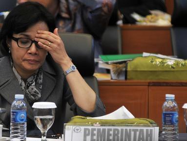 Menteri Keuangan Sri Mulyani saat mengikuti Rapat Kerja dengan Badan Anggaran (Banggar) DPR di Kompleks Parlemen, Senayan, Jakarta, Kamis (25/8). (Liputan6.com/Johan Tallo)
