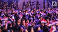 Ribuan kader Partai NasDem saat menghadiri pembukaan Kongres II Partai NasDem di JIExpo, Jakarta, Jumat (8/11/2019). Kongres II Partai NasDem yang digelar 8-11 November mengusung tema Restorasi Untuk Indonesia Maju. (Liputan6.com/Johan Tallo)