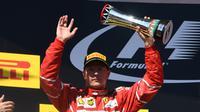 Kimi Raikkonen resmi memperpanjang kontrak dengan Ferrari hingga 2018. (AFP / ATTILA KISBENEDEK)
