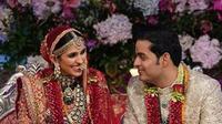 Pernikahan Putra Orang terkaya Asia, Akash Ambani dengan Shlok Mehta. (dok.Instagram @weddingz.in/https://www.instagram.com/p/Bu0CtKlnKNZ/Henry