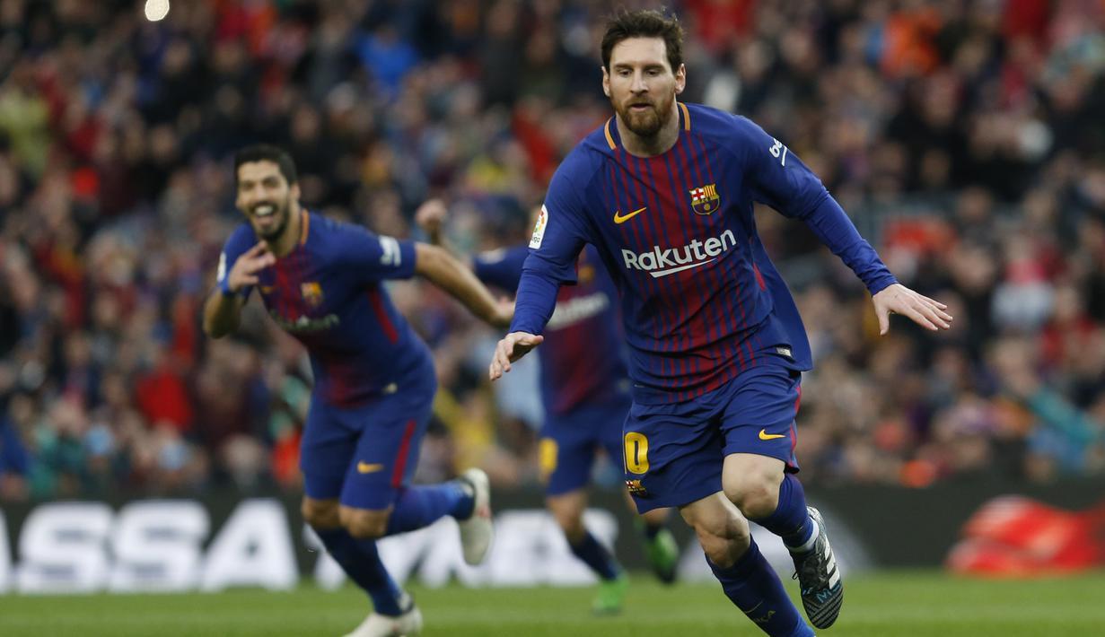 Gelandang Barcelona, Lionel Messi, merayakan gol yang dicetaknya ke gawang Atletico Madrid pada laga La Liga Spanyol di Stadion Camp Nou, Barcelona, Minggu (4/3/2018). Barcelona menang 1-0 atas Atletico. (AFP/Pau Barrena)