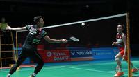 Tunggal putra Indonesia, Jonatan Christie, mengalahkan pemain Jepang, Kento Momota, pada babak kedua Malaysia Terbuka 2019, di Axiata Arena, Kamis (4/4/2019). (PBSI)