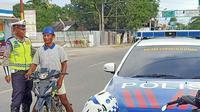 Satlantas Polres Gorontalo Utara menggelar razia lalu-lintas pada Kamis (30/1/2020). (Liputan6.com/ Arfandi Ibrahim)