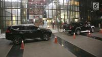 Mobil Mitsubishi Triton Exceed dan Pajero Sport Dakar diamankan KPK saat OTT Kalapas Sukamiskin Wahid Husein, di Gedung KPK, Jakarta, Sabtu (21/7). KPK menetapkan Kalapas sebagai tersangka dugaan suap jual fasilitas napi korupsi. (Liputan6.com/HO/Udin)