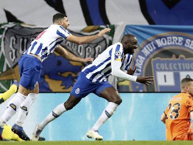 Pemain Porto, Moussa Marega, merayakan gol yang dicetak ke gawang Juventus pada laga Liga Champions di Stadion Dragao, Kamis (18/2/2021). Porto menang dengan skor 2-1. (AP/Luis Vieira)