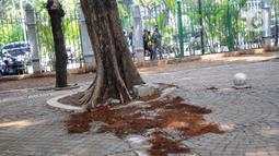 Suasana lokasi kejadian ledakan di kawasan Monumen Nasional, Jakarta, Selasa (3/12/2019).  Ledakan tersebut diduga berasal dari granat asap dan mengakibatkan dua orang anggota TNI terluka, korban langsung dievakuasi ke RSPAD Gatot Subroto Jakarta. (Liputan6.com/Helmi Fithriansyah)
