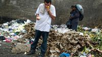 Warga Venezuela terpaksa makan dari tumpukan sampah demi bisa bertahan hidup di tengah krisis ekonomi (Reuters)