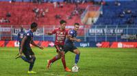 Bek kanan Bali United I Made Andhika Wijaya saat menghadapi Arema FC di Stadion Kanjuruhan, Malang, di Liga 1 2019. (Maheswara Putra/Bola.com)