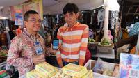 Pedagang di Pasar Beringharjo Yogyakarta bisa membayar retribusi secara non-tunai dengan LinkAja (Liputan6.com/ Switzy Sabandar)