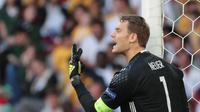 Manuel Neuer ditunjuk sebagai kapten Jerman per 1 September 2016 menggantikan Bastian Schweinsteiger yang memutuskan pensiun. (KENZO TRIBOUILLARD / AFP)