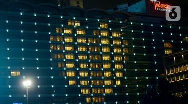 Dukung Tenaga Medis, Hotel Indonesia Kempinski Nyalakan Lampu Berbentuk Hati