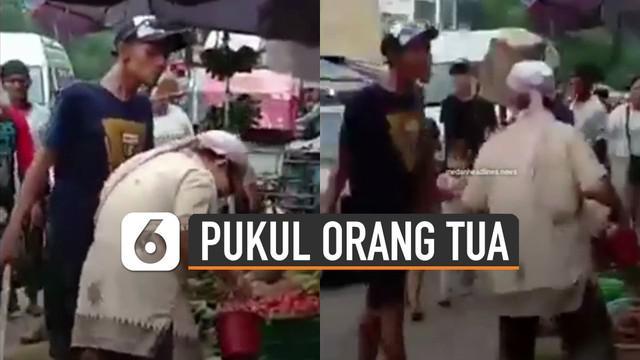 Aksi tidak terpuji dilakukan oleh pemuda yang diduga preman itu terhadap seorang pria paruh baya di sebuah pasar.