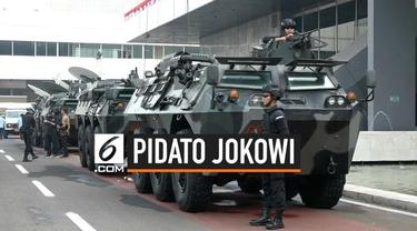 Pengamanan gedung MPR/DPR menjelang pidato presiden Jokowi Diperketat. Aparat keamanan memeriksa ketat semua tamu dan pegawai. Petugas Polisi dan TNi disebar di semua sudut gedung.