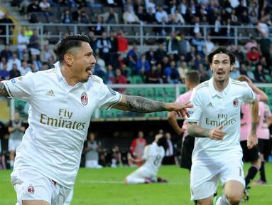 AC Milan meraih kemenangan 2-1 atas Palermo dalam laga pekan ke-12 Serie A yang berlangsung di Stadion Renzo Barbera, Minggu (6/11/2016). Gianluca Lapadula mencetak gol penentu kemenangan AC Milan. (AFP)