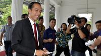 Joko Widodo kembali bertugas sebagai Gubernur DKI Jakarta menyusul berakhirnya masa cuti setelah dirinya ditetapkan sebagai Presiden terpilih Republik Indonesia periode 2014-2019 pada 22 Juli 2014, (23/7/2014). (ANTARA FOTO/Widodo S. Jusuf)