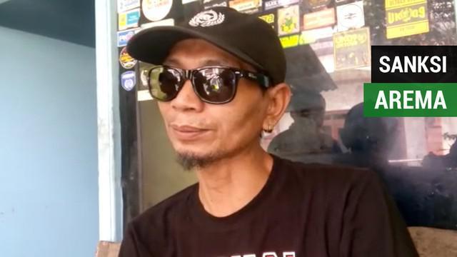 Berita video komentar dirigen Aremania yang kena sanksi seumur hidup tak bisa masuk stadion terkait sanksi yang diberikan kepada Arema FC.