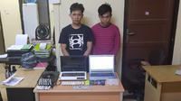Dua petani asal Kabupaten Sidrap nyambi jadi penipu online (Humas Polda Sulsel/ Eka Hakim)