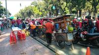 Pedagang dapat berkah saat hari buruh (Foto:Merdeka.com/Dwi Aditya Putra)