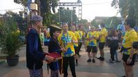 Christian Hadinata sesaat setelah menyelesaikan Kudus Relay Marathon (Liputan6.com / Achmad Yani Yustiawan)