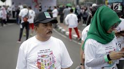 Peserta mengikuti kompetisi lari Democracy Run di Bundaran HI, Minggu (18/3). Sosialisasi pemilu ini jadi simbol penyelenggaraan pemilu yang harus berlari dan tidak ada waktu untuk berhenti sejenak. (Liputan6.com/Faizal Fanani)
