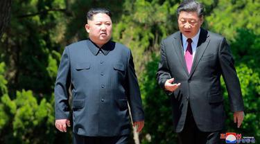 Xi Jinping dan Kim Jong-un