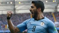 Penyerang Uruguay, Luis Suarez merayakan gol ke gawang Arab Saudi pada pertandingan kedua Grup A Piala Dunia 2018 di Rostov Arena, Rostov-on-Don, Rabu (20/6). Uruguay mengalahkan Arab Saudi 1-0 berkat gol Suarez di babak pertama. (AP/Andrew Medichini)