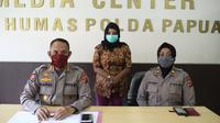 SBN, diduga melakukan ujaran kebencian dengan melakukan penhinaan kepada polisi dan Satpol PP saat pembatasan sosial terjadi di Jayapura. (Liputan6.com/Polda Papua/Katharina Janur)