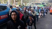 Para perantau asal Jawa Timur tiba di Bakorwil III Malang pada 2 Oktober 2019. Mereka pulang pasca kerusuhan Wamena (Liputan6.com/Zainul Arifin)