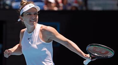 Petenis Rumania, Simona Halep merayakan kemenangannya atas Elise Mertens dari Belgia pada putaran keempat kejuaraan tenis Australia Terbuka di Melbourne, Australia, Senin (27/1/2020). (AP Photo/Andy Wong)