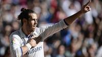 Gelandang Real Madrid, Gareth Bale, merayakan gol yang dicetaknya ke gawang Leganes pada laga La Liga di Stadion Santiago Bernabeu, Madrid, Minggu (6/11/2016). (AFP/Javier Soriano)