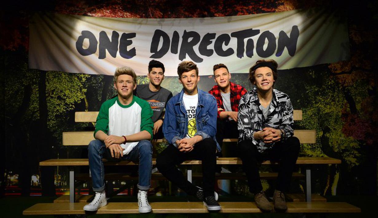Museum lilin Madame Tussauds di London membuatkan 'kembaran' boyband One Direction, Rabu (6/8/14). (AFP PHOTO/Carl COURT)