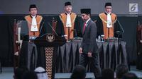 Presiden Joko Widodo (Jokowi) bersiap menyampaikan sambutannya saat menghadiri Pleno Mahkamah Agung (MA) RI tahun 2019 dalam rangka laporan tahunan MA tahun 2018 2018 di Jakarta, Rabu (27/2). (Liputan6.com/Faizal Fanani)