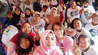 Emak-emak pendukung Jokowi siap menangkal hoaks. (Liputan6.com/Putu Surya Putra Merta)